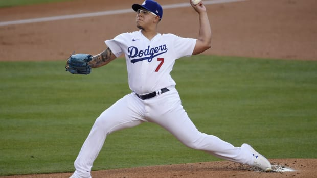 Aug 13, 2020; Los Angeles, California, USA; Los Angeles Dodgers relief pitcher Julio Urias (7) delivers a pitch during the first inning against the San Diego Padres at Dodger Stadium. Mandatory Credit: Kelvin Kuo-USA TODAY Sports