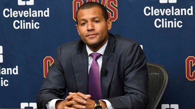 Cleveland Cavaliers general manager Koby Altman listens to a reporter's question during a press conference.