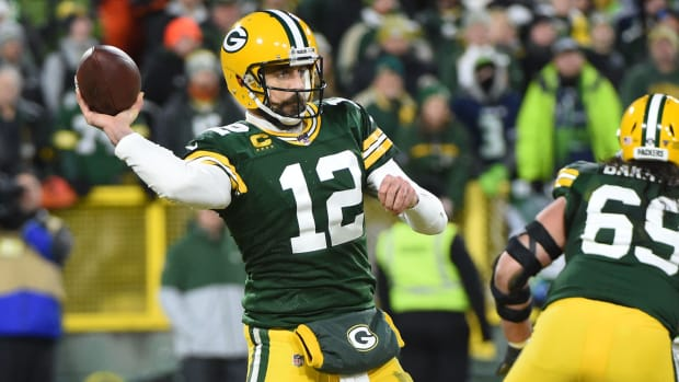 Aaron Rodgers throws a pass during a 2019-20 playoff game against the Seahawks