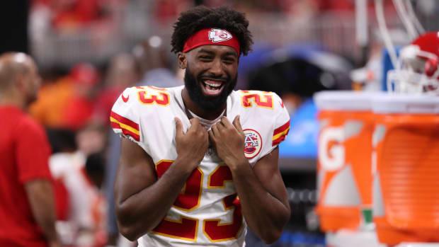 NFL DB Kendall Fuller laughs on the sideline