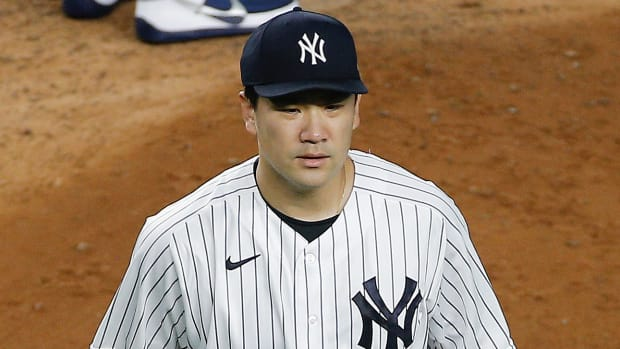New York Yankees starting pitcher Masahiro Tanaka (19) leaves the mound after being taken out of the game against the Tampa Bay Rays during the fifth inning at Yankee Stadium.