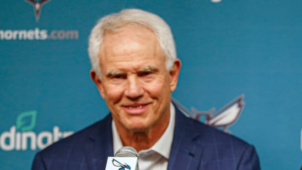 Charlotte Hornets general manager Mitch Kupchak answers questions from reporters at a press conference.