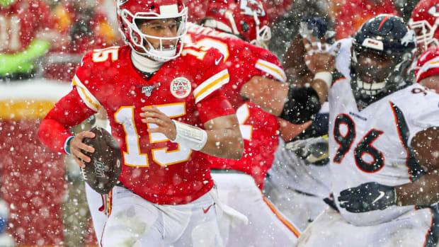 Dec 15, 2019; Kansas City, MO, USA; Kansas City Chiefs quarterback Patrick Mahomes (15) scrambles from Denver Broncos defensive tackle Shelby Harris (96) during the second half at Arrowhead Stadium. Mandatory Credit: Jay Biggerstaff-USA TODAY Sports