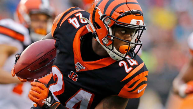 Cincinnati Bengals cornerback Darius Phillips (24) spins out of a tackle from Cleveland Browns cornerback Juston Burris (31) on a kick off return in the fourth quarter of the NFL Week 17 game between the Cincinnati Bengals and the Cleveland Browns at Paul Brown Stadium in downtown Cincinnati on Sunday, Dec. 29, 2019. The Bengals finished their 2019 campaign with a 33-23 win over the Browns. Cleveland Browns At Cincinnati Bengals