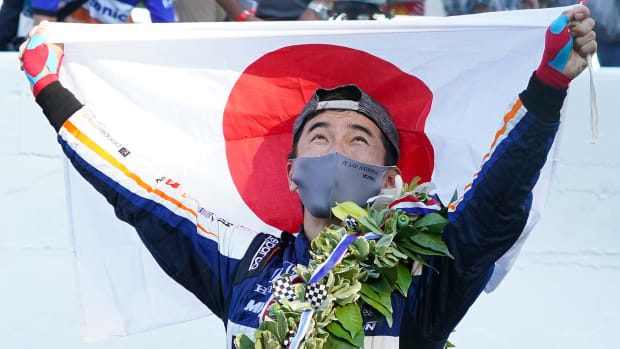 Indy Series driver Takuma Sato (30) reacts after winning the 104th Running of the Indianapolis 500 at Indianapolis Motor Speedway.