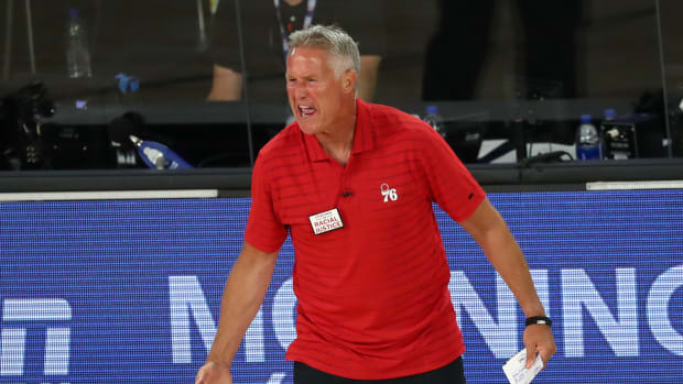 Philadelphia 76ers head coach Brett Brown reacts after receiving a technical foul against the Boston Celtics during the third quarter in game four of an NBA basketball first-round playoff series