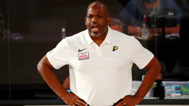 Indiana Pacers head coach Nate McMillan gives instruction during the first half of a NBA basketball game against the Miami Heat.