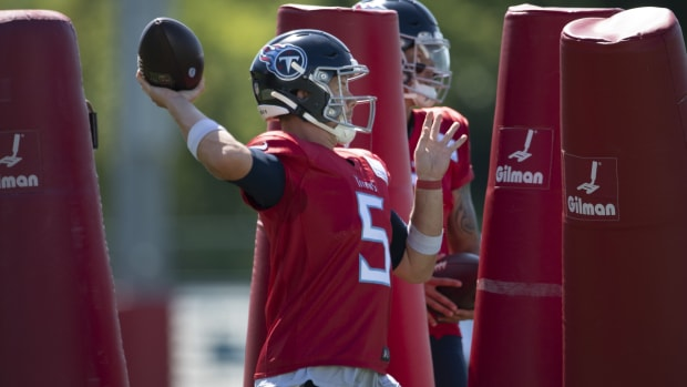 Tennessee Titans quarterback Logan Woodside (5) throws a pass during a training camp practice at Saint Thomas Sports Park Monday, Aug. 17, 2020 in Nashville, Tenn.