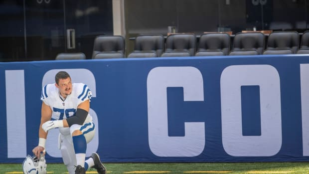 Indianapolis Colts center Ryan Kelly takes a knee before a Monday practice at Lucas Oil Stadium.