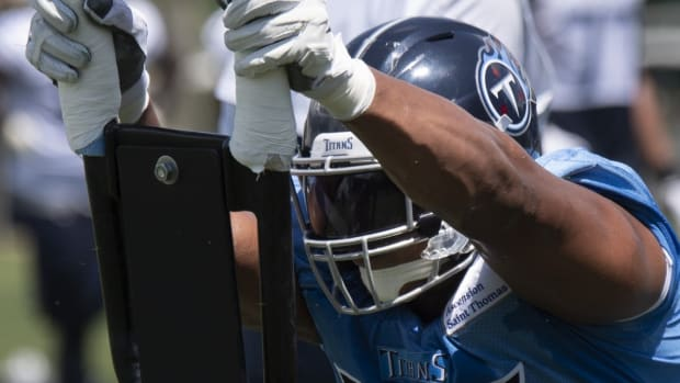 Nashville, Tennessee, USA; Tennessee Titans defensive lineman Jack Crawford (94) pushes a tackling sled during a training camp practice at Saint Thomas Sports Park.