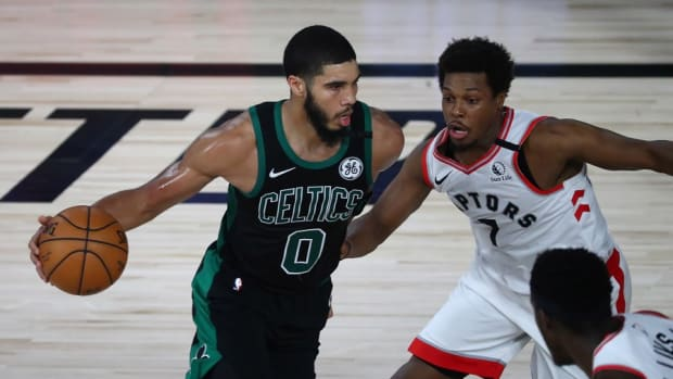 Boston Celtics forward Jayson Tatum (0) dribbles against Toronto Raptors guard Kyle Lowry (7) during the NBA Playoffs at The Field House.
