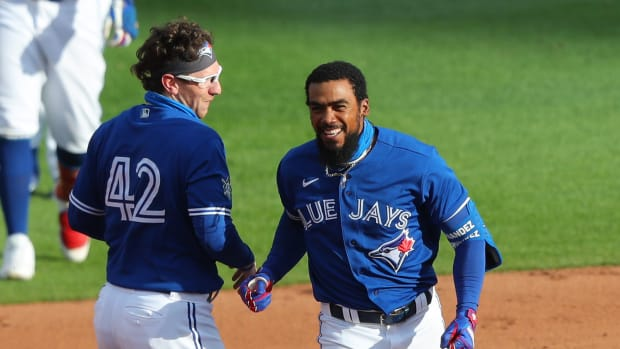 Toronto Blue Jays left fielder Teoscar Hernandez (right) celebrates with teammates after hitting the game winning RBI against the Baltimore Orioles during the ninth inning at Sahlen Field.