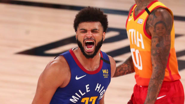 Denver Nuggets guard Jamal Murray (27) celebrates after making a three point basket against the Utah Jazz during the fourth quarter in game six of the first round of the 2020 NBA Playoffs