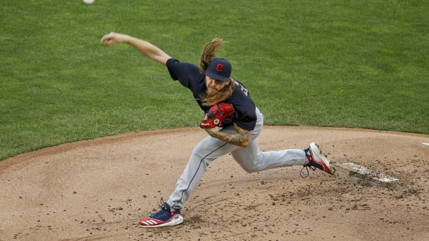 Jul 31, 2020; Minneapolis, Minnesota, USA; Cleveland Indians starting pitcher Mike Clevinger (52) throws to the Minnesota Twins in the first inning at Target Field. Mandatory Credit: Bruce Kluckhohn-USA TODAY Sports