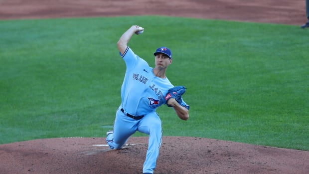Toronto Blue Jays starting pitcher Jacob Waguespack (62) throws a pitch during the first inning against the Philadelphia Phillies at Sahlen Field. Mandatory Credit: Timothy T. Ludwig-USA TODAY Sports
