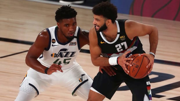 Denver Nuggets guard Jamal Murray (27) controls the ball against Utah Jazz guard Donovan Mitchell (45) during the second half of game seven of the first round of the 2020 NBA Playoffs at ESPN Wide Wor...