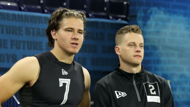 Feb 27, 2020; Indianapolis, Indiana, USA; Oregon Ducks quarterback Justin Herbert (QB07) and Louisiana State Tigers quarterback Joe Burrow (QB02) watch from the sidelines during the 2020 NFL Combine at Lucas Oil Stadium. Mandatory Credit: Brian Spurlock-USA TODAY Sports