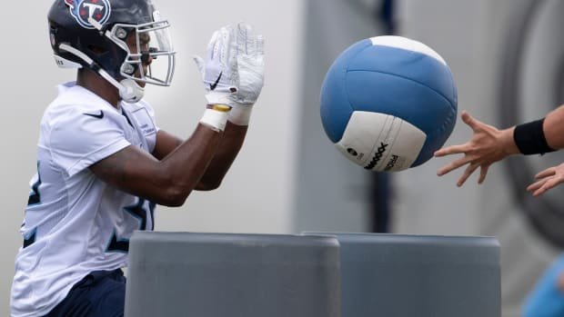 Tennessee Titans running back Darrynton Evans (32) works on blocking drills during a training camp practice at Saint Thomas Sports Park Friday, Aug. 14, 2020 in Nashville, Tenn.