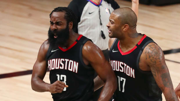 Houston Rockets guard James Harden (13) reacts with forward P.J. Tucker (17) and forward Robert Covington (right) after a play against the Oklahoma City Thunder