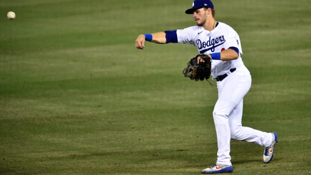 September 1, 2020; Los Angeles, California, USA; Los Angeles Dodgers second baseman Gavin Lux (9) throws to first for the out against Arizona Diamondbacks right fielder Kole Calhoun (56) during the fourth inning at Dodger Stadium. Mandatory Credit: Gary A. Vasquez-USA TODAY Sports