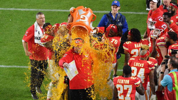 Feb 2, 2020; Miami Gardens, Florida, USA; Kansas City Chiefs head coach Andy Reid is dunked with Gatorade by his players Jordan Lucas (24) and Cameron Erving (75) in the fourth quarter in Super Bowl LIV against the San Francisco 49ers at Hard Rock Stadium. Mandatory Credit: Steve Mitchell-USA TODAY Sports