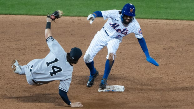 New York Mets center fielder Billy Hamilton (21) steals second base ahead of thee tag bypass New York Yankees shortstop Tyler Wade (14) during the ninth inning at Citi Field.