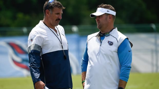 Titans head coach Mike Vrabel talks with general manager Jon Robinson after practice at Saint Thomas Sports Park Friday, July 26, 2019, in Nashville, Tenn.
