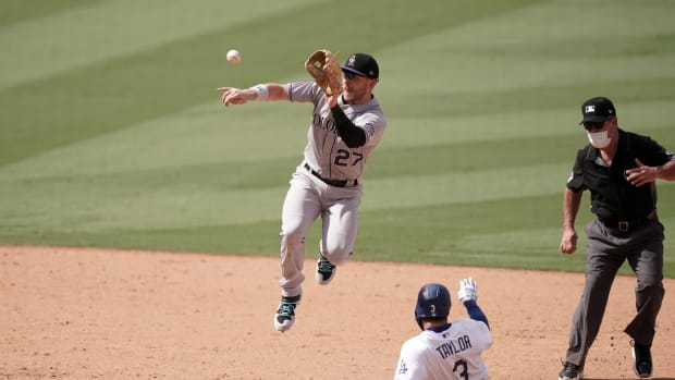Aug 23, 2020; Los Angeles, California, USA; Los Angeles Dodgers left fielder Chris Taylor (3) slides into second base to beat a throw to Colorado Rockies shortstop Trevor Story (27) for a stolen base in the seventh inning at Dodger Stadium. Mandatory Credit: Kirby Lee-USA TODAY Sports