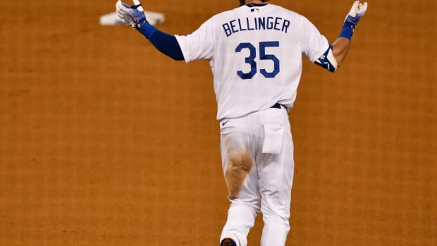Aug 22, 2020; Los Angeles, California, USA; Los Angeles Dodgers center fielder Cody Bellinger (35) rounds the bases unsure if his deep flyball to right field was called a home run in the ninth inning at Dodger Stadium. Bellinger's blast was called a homer as the Dodgers defeated the Colorado Rockies 4-3 Mandatory Credit: Robert Hanashiro-USA TODAY Sports