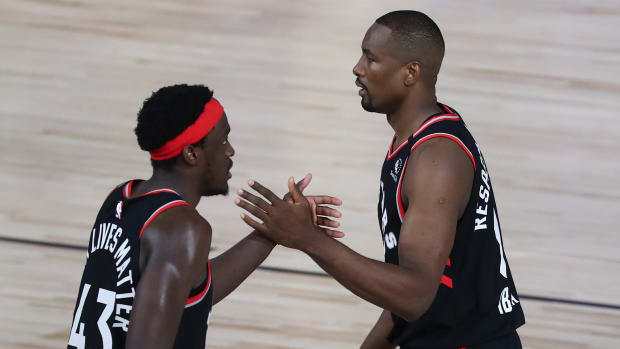 Toronto Raptors forward Pascal Siakam (43) celebrates with center Serge Ibaka (right) after defeating the Boston Celtics game four in the second round of the 2020 NBA Playoffs