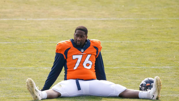 Denver Broncos offensive tackle Calvin Anderson (76) stretches during training camp at the UCHealth Training Center.