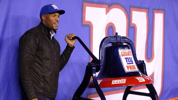 Nov 14, 2016; East Rutherford, NJ, USA; New York Giants former defensive end Michael Strahan rings a bell before a game between the New York Giants and the Cincinnati Bengals at MetLife Stadium.
