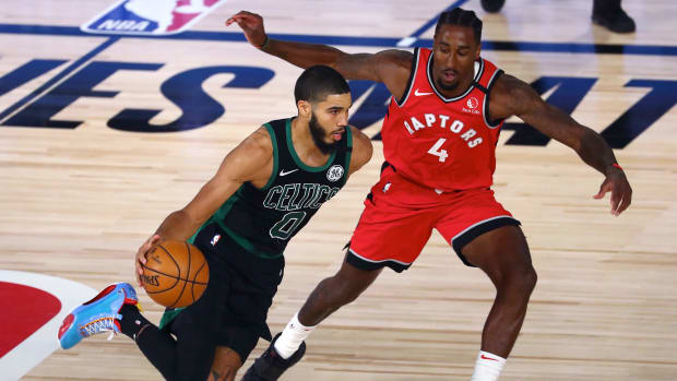 Boston Celtics forward Jayson Tatum (0) dribbles the ball against Toronto Raptors forward Rondae Hollis-Jefferson (4) during the second half of game five of the second round in the 2020 NBA Playoffs