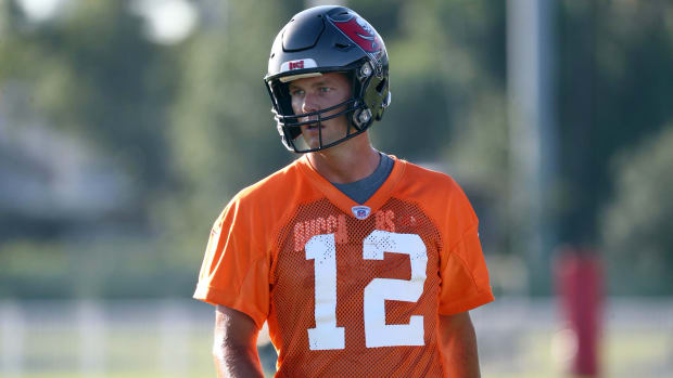 Tampa Bay Buccaneers quarterback Tom Brady (12) works out at AdventHealth Training Center.