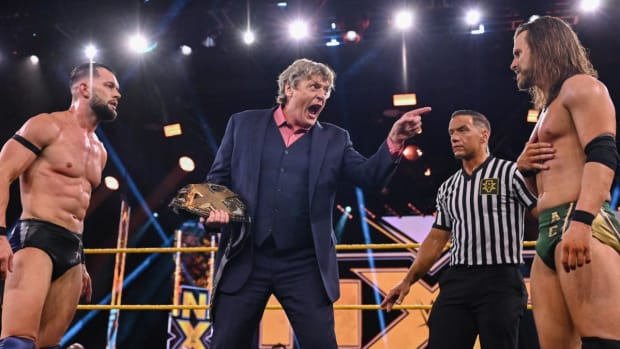 William Regal stands between Finn Balor and Adam Cole in the ring on NXT