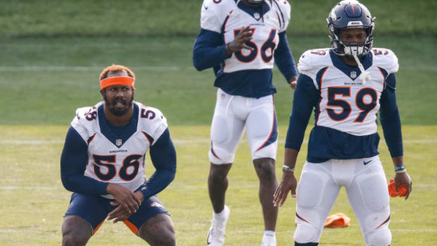 Denver Broncos running back Melvin Gordon III (25) and linebacker Von Miller (58) and linebacker Malik Reed (59) during training camp at the UCHealth Training Center.