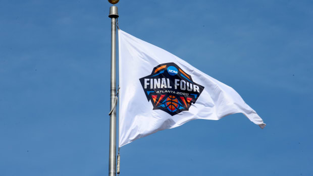 Mar 13, 2020; Indianapolis, Indiana, USA; A 2020 Final Four Atlanta flag flies above the NCAA Headquarters building following the cancellation of the Division I mens and womens 2020 basketball tournaments as well as all remaining winter and spring NCAA championships due to the Covid 19 Covid 19 coronavirus pandemic. Atlanta was to be the site of the 2020 mens Final Four. Mandatory Credit: Brian Spurlock-USA TODAY Sports