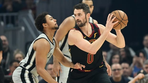 Cleveland Cavaliers forward Kevin Love (0) holds the ball as San Antonio Spurs guard Bryn Forbes (11) defends during the first half at Rocket Mortgage FieldHouse.