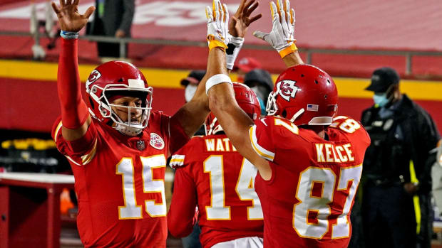 Sep 10, 2020; Kansas City, Missouri, USA; Kansas City Chiefs quarterback Patrick Mahomes (15) and tight end Travis Kelce (87) celebrate after a touchdown during the first half against the Houston Texans at Arrowhead Stadium. Mandatory Credit: Denny Medley-USA TODAY Sports