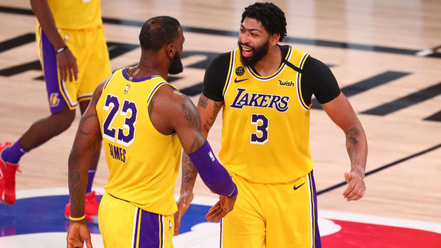 Lakers forward Anthony Davis celebrates with LeBron James after making a basket in the second half against the Houston Rockets