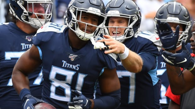 Tennessee Titans tight end Jonnu Smith (81) celebrates with Tennessee Titans quarterback Ryan Tannehill (17) after a touchdown during the first half against the Tampa Bay Buccaneers at Nissan Stadium.