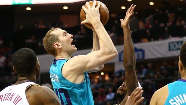 Charlotte Hornets center Cody Zeller shoots the ball against Denver Nuggets forward Paul Millsap (4) during the second half at Spectrum Center.