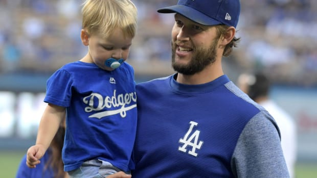 Aug 20, 2018; Los Angeles, CA, USA; Los Angeles Dodgers starting pitcher Clayton Kershaw holds his son Charley Kershaw before the game against the St. Louis Cardinals at Dodger Stadium.The Cardinals defeated the Dodgers 5-3. Mandatory Credit: Kirby Lee-USA TODAY Sports