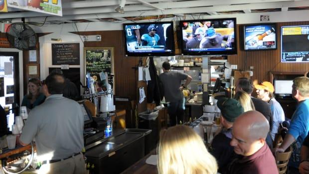 Football on TV at a bar