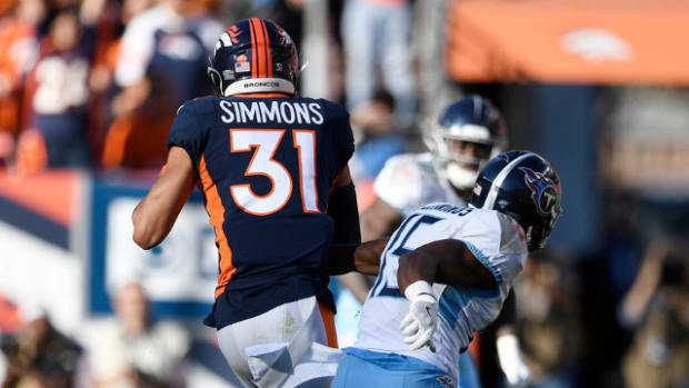 Justin Simmons (31) races up the field past Tennessee Titans wide receiver Darius Jennings (15) with an interception during the third quarter at Empower Field at Mile High Sunday, Oct. 13, 2019 in Denver, Colo.