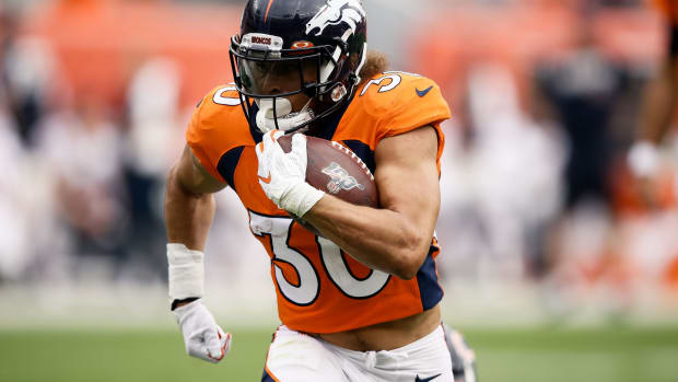 Sep 15, 2019; Denver, CO, USA; Denver Broncos running back Phillip Lindsay (30) runs the ball in the fourth quarter against the Chicago Bears at Empower Field at Mile High.