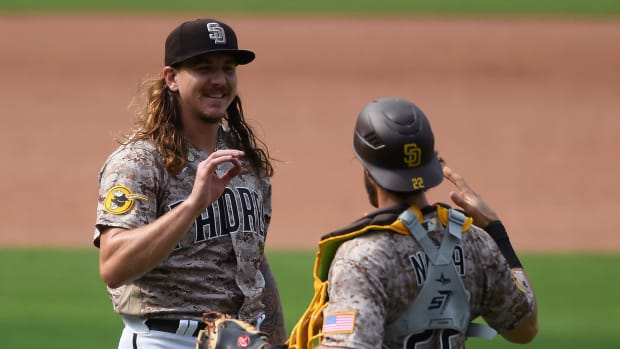 San Diego Padres starting pitcher Mike Clevinger (L) and catcher Austin Nola (22) celebrate after defeating the San Francisco Giants at Petco Park.