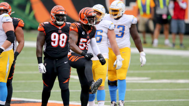 Cincinnati Bengals middle linebacker Josh Bynes (56) celebrates a tackle in the second quarter during a Week 1 NFL football game against the Los Angeles Chargers, Sunday, Sept. 13, 2020, at Paul Brown Stadium in Cincinnati. Los Angeles Chargers At Cincinnati Bengals Sept 13