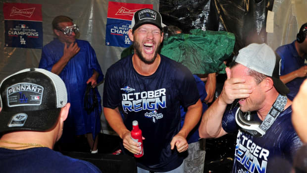 Sep 10, 2019; Baltimore, MD, USA; Los Angeles Dodgers pitcher Clayton Kershaw (center) celebrates after clinching the NL West division after defeating the Baltimore Orioles at Oriole Park at Camden Yards. Mandatory Credit: Evan Habeeb-USA TODAY Sports