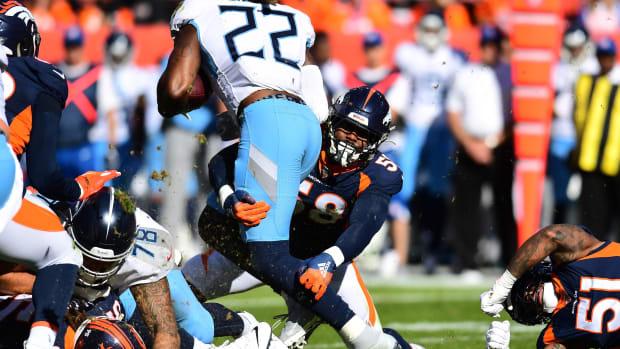 Denver Broncos linebacker Von Miller (58) tackles Tennessee Titans running back Derrick Henry (22) in the second quarter at Empower Field at Mile High.